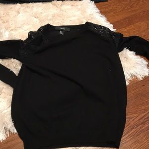 Women's black sweater with lace on the shoulders